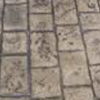cobblestone-pattern-stamped-concrete-with-charcoal-antiquing
