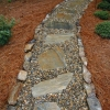 Mohave flagstone and Tennessee river gravel path bordered with Tennessee medium stack fieldstone