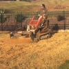turf-renovation-tilling-the-soil-in-the-yard-to-prepare-for-the-soil-amendments