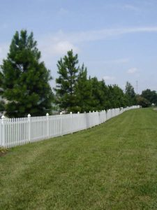 white vinyl fencing installed at the entrance of a subdivision that we built