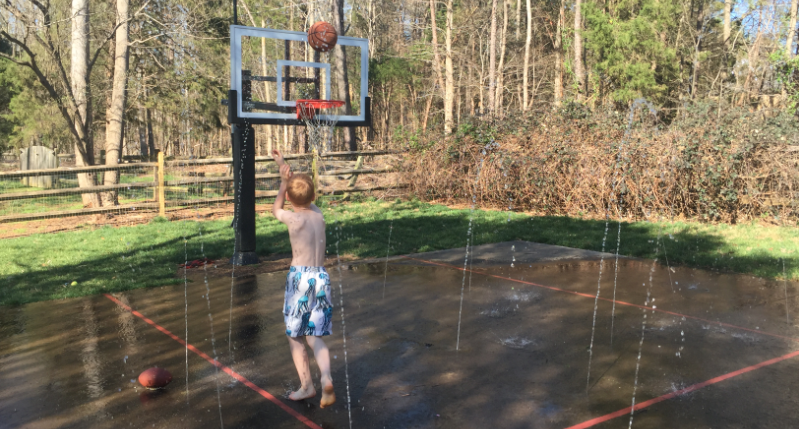 CUSTOM BASKETBALL COURT WITH BUILT-IN SPRAY GROUND